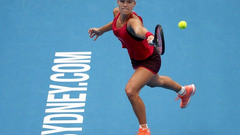 Angelique Kerber of Germany hits a backhand to Ash Barty of Australia during their women's final singles match at the Sydney International tennis tournament in Sydney, Saturday, Jan. 13, 2018. (AP Photo/Rick Rycroft)