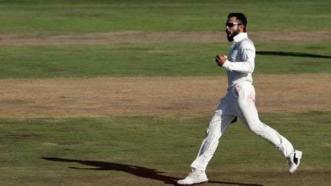 India's captain Virat Kohli, reacts after making a catch to dismiss South Africa's batsman Quinton de Kock' for a duck during the first day of the second cricket test match between South Africa and India at Centurion Park in Pretoria, South Africa, Saturday, Jan. 13, 2018. (AP Photo/Themba Hadebe)