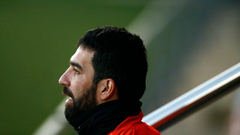 FILE - In this Monday, Dec. 4, 2017 file photo, FC Barcelona's Arda Turan takes part in a training session at the Sports Center FC Barcelona Joan Gamper in Sant Joan Despi, Spain. Barcelona says Arda Turan will play on loan with Turkish club Istanbul Basaksehir for the rest of this season and two more.  (AP Photo/Manu Fernandez, File)