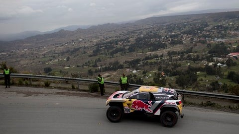 Peugeot driver Stephane Peterhansel and co-driver Jean Paul Cottret, both of France, depart from La Paz, Bolivia, for the Dakar Rally stage 7 on Saturday, Jan. 13, 2018. (AP Photo/Juan Karita)