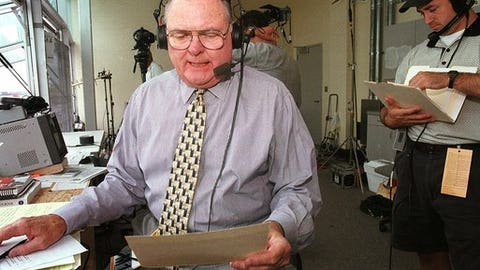 ABC television sports commentator Keith Jackson reads through a checklist prior to the Nebraska-California football game Saturday, Sept. 11, 1999 in Lincoln, Neb. Jackson came out of retirement to give the play-by-play for the PAC 10 colleges over the next three years. (AP Photo/S.E. McKee)