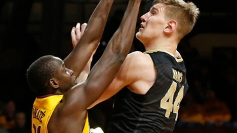 Purdue's Isaac Haas, right, shoots over Minnesota's Bakary Konate of Mali in the first half of an NCAA college basketball game Saturday, Jan. 13, 2018, in Minneapolis. (AP Photo/Jim Mone)