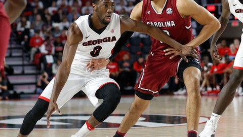 Georgia guard William Jackson (0) moves the ball down the court against South Carolina in the first half of an NCAA college basketball game in Athens, Ga., Saturday, Jan. 13, 2018. (Joshua L. Jones/Athens Banner-Herald via AP)