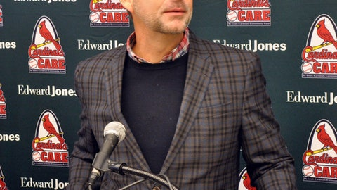 St. Louis Cardinals President John Mozeliak answers a question during a baseball news conference before the team's annual Winter Warm-Up on Saturday, Jan. 13, 2018 in St. Louis. Mozeliak said the Cardinals have improved after missing the playoffs for a second straight season last year thanks to deals such as a trade for outfielder Marcell Ozuna, and he continues to explore other possible trades or free agent signings. (AP Photo/Kurt Voigt)