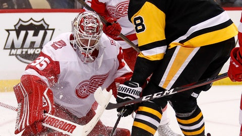 Pittsburgh Penguins' Brian Dumoulin (8) can't get his stick on a rebound in front of Detroit Red Wings goaltender Jimmy Howard (35) in the second period of an NHL hockey game in Pittsburgh, Saturday, Jan. 13, 2018. (AP Photo/Gene J. Puskar)
