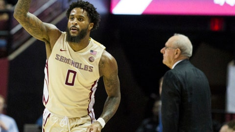 Florida State's Phil Cofer reacts to hitting a three point shot in the first half of an NCAA college basketball game against Syracuse in Tallahassee, Fla., Saturday, Jan. 13, 2018. (AP Photo/Mark Wallheiser)