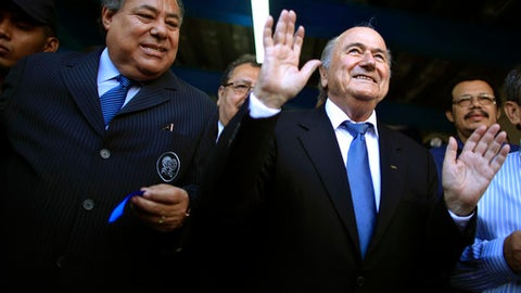"""FILE - This April 14, 2011 file photo shows Nicaragua Soccer Federation President Julio Rocha, left, and FIFA President Joseph S. Blatter, at the end of a ceremonial ribbon cutting for the National Soccer Stadium in Managua, Nicaragua. The head of the Nicaraguan Soccer Federation says his predecessor Julio Rocha, who was convicted in the United States in a corruption scandal at the sport's world governing body, FIFA, died on Saturday, Jan. 13, 2018, after an illness he had had """"for several months."""" Rocha was 67. (AP Photo/Esteban Felix, File)"""