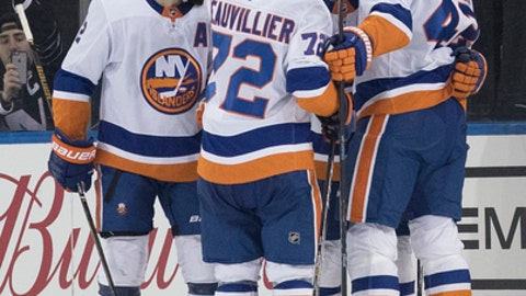 New York Islanders center Mathew Barzal, center, celebrates with his teammates after scoring a goal during the second period of an NHL hockey game against the New York Rangers, Saturday, Jan. 13, 2018, at Madison Square Garden in New York. (AP Photo/Mary Altaffer)