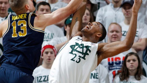 Michigan State's Xavier Tillman, right, and Michigan's Moritz Wagner (13) fight for a rebound during the second half of an NCAA college basketball game, Saturday, Jan. 13, 2018, in East Lansing, Mich. Michigan won 82-72. (AP Photo/Al Goldis)