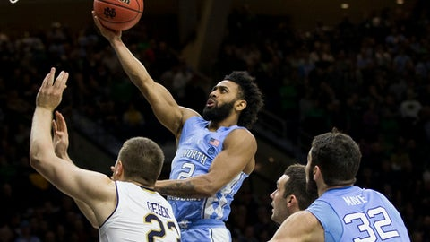 North Carolina's Joel Berry II (2) goes up for a shot over Notre Dame's Martinas Geben (23) during the first half of an NCAA college basketball game Saturday, Jan. 13, 2018, in South Bend, Ind. (AP Photo/Robert Franklin)