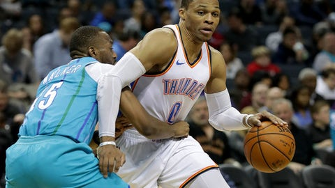 CHARLOTTE, NC - JANUARY 13:  Russell Westbrook #0 of the Oklahoma City Thunder drives to the basket against Kemba Walker #15 of the Charlotte Hornets during their game at Spectrum Center on January 13, 2018 in Charlotte, North Carolina.  NOTE TO USER: User expressly acknowledges and agrees that, by downloading and or using this photograph, User is consenting to the terms and conditions of the Getty Images License Agreement.  (Photo by Streeter Lecka/Getty Images)