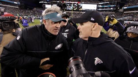 Philadelphia Eagles head coach Doug Pederson, left, and Atlanta Falcons head coach Dan Quinn meet after an NFL divisional playoff football game, Saturday, Jan. 13, 2018, in Philadelphia. Philadelphia won 15-10. (AP Photo/Matt Rourke)