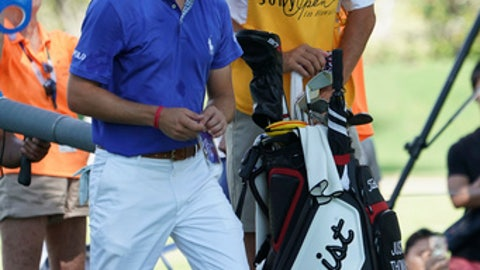 "Justin Thomas, left, Jim ""Bones"" Mackay watch a pairing partner drive off the eight tee box during the third round of the Sony Open golf tournament, Saturday Jan. 13, 2018, in Honolulu. Although he retired last year, MacKay is filling in for Thomas' injured caddie. (AP Photo/Marco Garcia)"