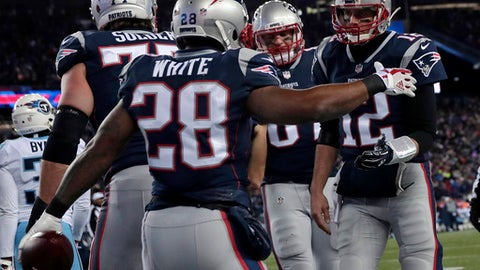 New England Patriots running back James White (28) celebrates his touchdown with quarterback Tom Brady, right, during the first half of an NFL divisional playoff football game, Saturday, Jan. 13, 2018, in Foxborough, Mass. (AP Photo/Charles Krupa)