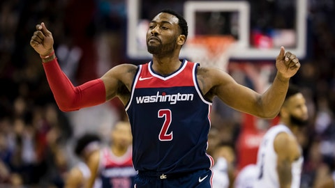 WASHINGTON, DC - JANUARY 13: John Wall #2 of the Washington Wizards celebrates in overtime during the game between the Washington Wizards and the Brooklyn Nets at Capital One Arena on January 13, 2018 in Washington, DC. NOTE TO USER: User expressly acknowledges and agrees that, by downloading and or using this photograph, User is consenting to the terms and conditions of the Getty Images License Agreement. (Photo by Scott Taetsch/Getty Images)