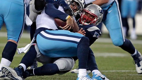 New England Patriots defensive tackle Adam Butler, rear, sacks Tennessee Titans quarterback Marcus Mariota during the second half of an NFL divisional playoff football game, Saturday, Jan. 13, 2018, in Foxborough, Mass. (AP Photo/Charles Krupa)