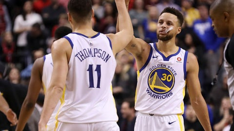 TORONTO, ON - JANUARY, 13  During a break in the dying seconds of the game, Golden State Warriors guard Stephen Curry (30) and Klay Thompson (11) have a high five. The Toronto Raptors lost to the Golden State Warriors 125-127 in NBA basketball action at the Air Canada Centre in Toronto. January, 13 2018        (Richard Lautens/Toronto Star via Getty Images)