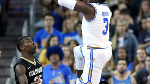 UCLA guard Aaron Holiday, right, shoots as Colorado guard McKinley Wright IV defends during the first half of an NCAA college basketball game Saturday, Jan. 13, 2018, in Los Angeles. (AP Photo/Mark J. Terrill)