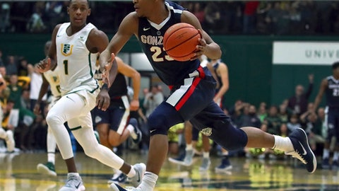 Gonzaga's Zach Norvell Jr., right, drives against San Francisco's Jamaree Bouyea (1) during the second half of an NCAA college basketball game Saturday, Jan. 13, 2018, in San Francisco. (AP Photo/Ben Margot)