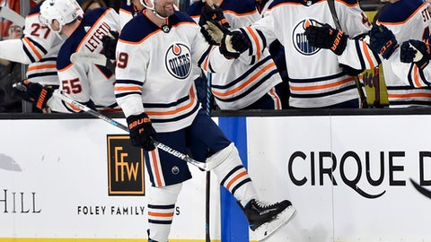 Edmonton Oilers left wing Patrick Maroon (19) celebrates with his teammates after scoring a goal against the Vegas Golden Knights during the second period of an NHL hockey game Saturday, Jan. 13, 2018, in Las Vegas. (AP Photo/David Becker)