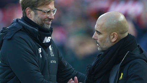 Liverpool's manager Juergen Klopp, left, shakes hands with Manchester City's manager Pep Guardiola prior to the English Premier League soccer match between Liverpool and Manchester City at Anfield Stadium, in Liverpool, England, Sunday Jan. 14, 2018. (AP Photo/Dave Thompson)