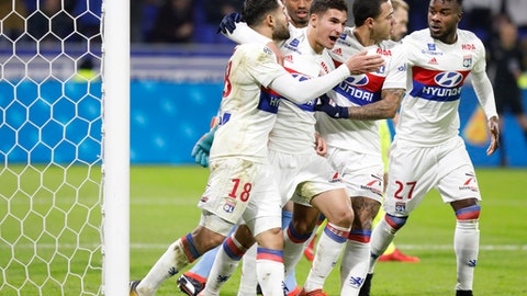 Lyon's players celebrate after Nabil Fekir, left, scored a goal against Angers during their French League One soccer match in Decines, near Lyon, central France, Sunday, Jan. 14, 2018. (AP Photo/Laurent Cipriani)