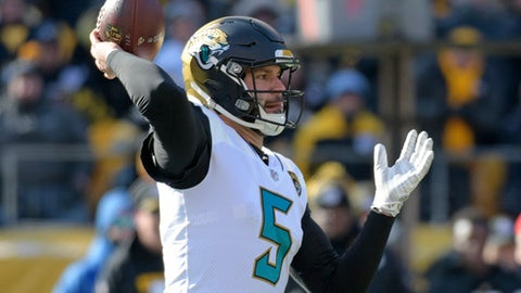 Jacksonville Jaguars quarterback Blake Bortles (5) throws a pass during the first half of an NFL divisional football AFC playoff game against the Pittsburgh Steelers in Pittsburgh, Sunday, Jan. 14, 2018. (AP Photo/Don Wright)