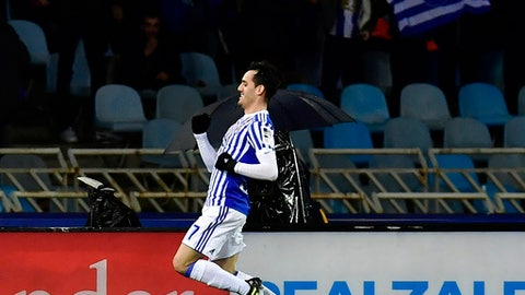 Real Sociedad's Juammi Jimenez celebrates his goal and the second of his team against FC Barcelona during the Spanish La Liga soccer match between Barcelona and Real Sociedad, at Anoeta stadium, in San Sebastian, northern Spain, Sunday, Jan. 14, 2018. (AP Photo/Alvaro Barrientos)