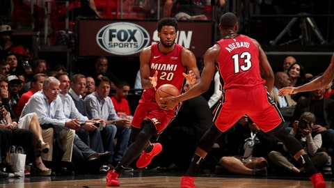 MIAMI, FL - JANUARY 14:  Bam Adebayo #13 passes the ball to Justise Winslow #20 of the Miami Heat during the game against the Milwaukee Bucks on January 14, 2018 at American Airlines Arena in Miami, Florida. NOTE TO USER: User expressly acknowledges and agrees that, by downloading and or using this Photograph, user is consenting to the terms and conditions of the Getty Images License Agreement. Mandatory Copyright Notice: Copyright 2018 NBAE (Photo by Issac Baldizon/NBAE via Getty Images)