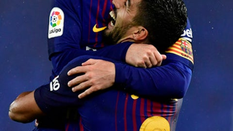 FC Barcelona's Lionel Messi celebrates the fourth goal of his team with Luis Suarez after scoring against Real Sociedad during the Spanish La Liga soccer match between Barcelona and Real Sociedad, at Anoeta stadium, in San Sebastian, northern Spain, Sunday, Jan.14, 2018. (AP Photo/Alvaro Barrientos)