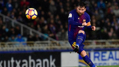 FC Barcelona's Lionel Messi kicks the ball and scores the fourth goal of his team against Real Sociedad during the Spanish La Liga soccer match between Barcelona and Real Sociedad, at Anoeta stadium, in San Sebastian, northern Spain, Sunday, Jan.14, 2018. (AP Photo/Alvaro Barrientos)
