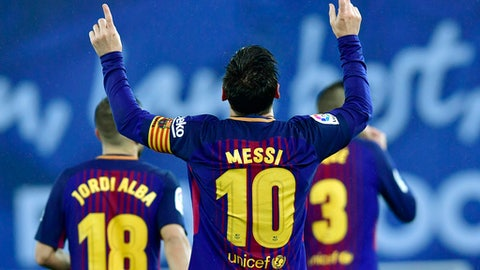 FC Barcelona's Lionel Messi celebrates the fourth of his team after scoring against Real Sociedad during the Spanish La Liga soccer match between Barcelona and Real Sociedad, at Anoeta stadium, in San Sebastian, northern Spain, Sunday, Jan.14, 2018. (AP Photo/Alvaro Barrientos)
