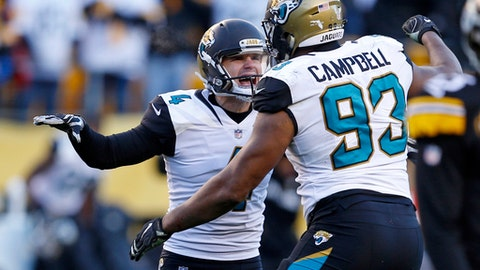 Jacksonville Jaguars kicker Josh Lambo (4) celebrates with Calais Campbell (93) after kicking a field goal during the second half of an NFL divisional football AFC playoff game against the Pittsburgh Steelers in Pittsburgh, Sunday, Jan. 14, 2018. The Jaguars won 45-42. (AP Photo/Keith Srakocic)