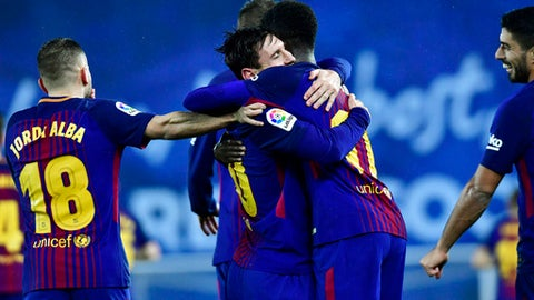 FC Barcelona's Lionel Messi, center left, celebrates with Ousmane Dembele after scoring the fourth goal of his team during the Spanish La Liga soccer match between Barcelona and Real Sociedad, at Anoeta stadium, in San Sebastian, northern Spain, Sunday, Jan.14, 2018. (AP Photo/Alvaro Barrientos)