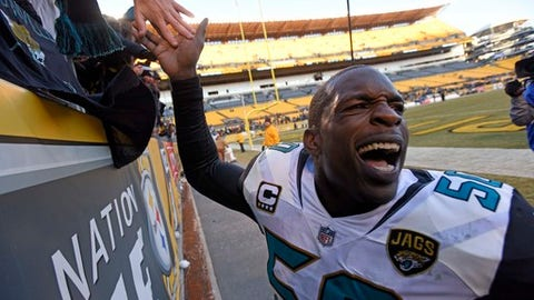 Jacksonville Jaguars outside linebacker Telvin Smith (50) celebrates with fans after a win over the Pittsburgh Steelers in an NFL divisional football AFC playoff game in Pittsburgh, Sunday, Jan. 14, 2018. (AP Photo/Don Wright)