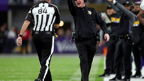 Minnesota Vikings head coach Mike Zimmer questions line judge Mark Steinkerchner (84) during the first half of an NFL divisional football playoff game against the New Orleans Saints in Minneapolis, Sunday, Jan. 14, 2018. (AP Photo/Charlie Neibergall)