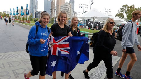 Spectators make their way into Melbourne Park to watch the first round matches on day one at the Australian Open tennis championships in Melbourne, Australia, Monday, Jan. 15, 2018. (AP Photo/Ng Han Guan)