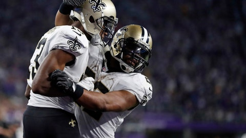 New Orleans Saints wide receiver Michael Thomas (13) celebrates his touchdown with running back Mark Ingram (22) during the second half of an NFL divisional football playoff game against the Minnesota Vikings in Minneapolis, Sunday, Jan. 14, 2018. (AP Photo/Jeff Roberson)