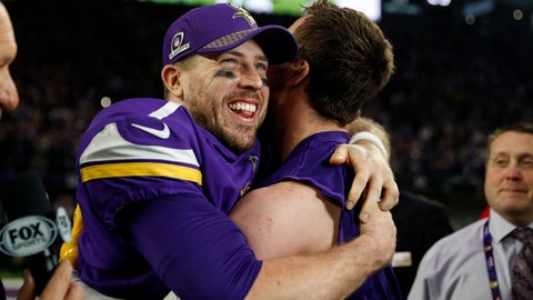 Minnesota Vikings quarterback Case Keenum, left, celebrates after a 29-24 win over the New Orleans Saints during the second half of an NFL divisional football playoff game in Minneapolis, Sunday, Jan. 14, 2018. (AP Photo/Jeff Roberson)
