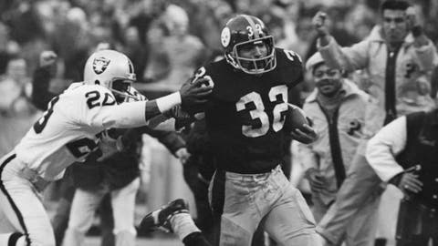 FILE - In this Dec. 23, 1972, file photo, Franco Harris (32) of the Pittsburgh Steelers eludes a tackle by Jimmy Warren of the Oakland Raiders on a 42-yard run to score the winning touchdown in the American Conference playoff game in Pittsburgh. The Minnesota Vikings' last-second playoff win over the New Orleans Saints brought back memories of another desperation playoff touchdown, the Immaculate Reception. (AP Photo/Harry Cabluck, File)