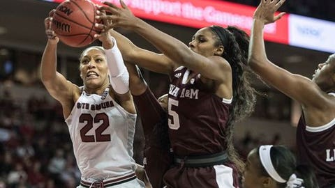 FILE - In this Dec. 31, 2017, file photo, South Carolina forward A'ja Wilson (22) grabs a rebound against Texas A&M forward Anriel Howard (5) during the second half of an NCAA college basketball game in Columbia, S.C. A panel of WNBA coaches and general managers put together mock selections for the first round of the league's draft that will take place in April. They were only allowed to choose seniors in their final season of eligibility and foreign players for the draft and couldn't make pick for their own teams. (AP Photo/Sean Rayford, File)