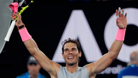 Spain's Rafael Nadal waves after defeating Victor Estrella Burgos of the Dominican Republic during their first round match at the Australian Open tennis championships in Melbourne, Australia, Monday, Jan. 15, 2018. (AP Photo/Vincent Thian)