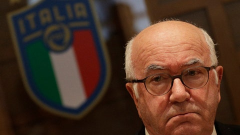 FILE - In this Monday, Nov. 20, 2017 filer, Italian football federation president Carlo Tavecchio gives a press conference at the federation headquarters in Rome. Italian football federation president Carlo Tavecchio has resigned Monday, after failure to qualify for World Cup. Three candidates have stepped forward to replace Carlo Tavecchio as president of the Italian football federation. The candidates are: Gabriele Gravina, president of the Lega Pro (Serie C); Cosimo Sibilia, president of the Lega Nazionale Dilettanti (amateur league); and Damiano Tommasi, president of the Associazione Italiana Calciatori (footballers' association). The vote will be held in Rome in two weeks. (AP Photo/Andrew Medichini, File)