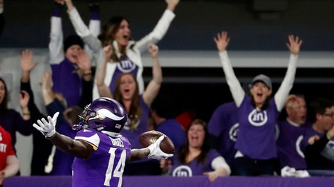 FILE - In this Sunday, Jan. 14, 2018, file photo, Minnesota Vikings wide receiver Stefon Diggs (14) celebrates in the end zone after a making the game-winning touchdown against the New Orleans Saints late the second half of an NFL divisional football playoff game in Minneapolis,. The Vikings defeated the Saints 29-24. (AP Photo/Jeff Roberson, File)