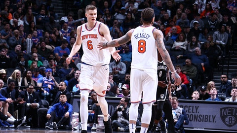 BROOKLYN, NY - JANUARY 15:  Kristaps Porzingis #6 and Michael Beasley #8 of the New York Knicks high five during the game against the Brooklyn Nets on January 15, 2018 at Barclays Center in Brooklyn, New York. NOTE TO USER: User expressly acknowledges and agrees that, by downloading and or using this Photograph, user is consenting to the terms and conditions of the Getty Images License Agreement. Mandatory Copyright Notice: Copyright 2018 NBAE (Photo by Nathaniel S. Butler/NBAE via Getty Images)