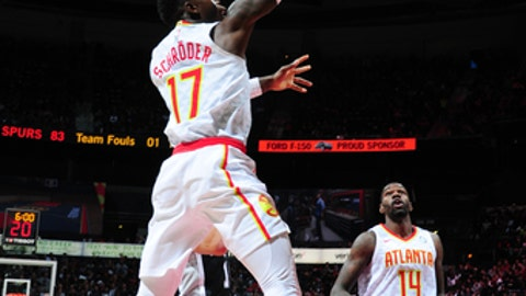 ATLANTA, GA - JANUARY 15: Dennis Schroder #17 of the Atlanta Hawks shoots the ball during the game against the San Antonio Spurs on January 15, 2018 at Philips Arena in Atlanta, Georgia.  NOTE TO USER: User expressly acknowledges and agrees that, by downloading and/or using this Photograph, user is consenting to the terms and conditions of the Getty Images License Agreement. Mandatory Copyright Notice: Copyright 2018 NBAE (Photo by Scott Cunningham/NBAE via Getty Images)