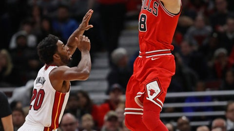 CHICAGO, IL - JANUARY 15:   Zach LaVine #8 of the Chicago Bulls shoots over Justise Winslow #20 of the Miami Heat at the United Center on January 15, 2018 in Chicago, Illinois. NOTE TO USER: User expressly acknowledges and agrees that, by downloading and or using this photograph, User is consenting to the terms and conditions of the Getty Images License Agreement. (Photo by Jonathan Daniel/Getty Images)