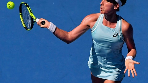 Britain's Johanna Konta makes a forehand return to United States' Madison Brengle during their first round match at the Australian Open tennis championships in Melbourne, Australia, Tuesday, Jan. 16, 2018. (AP Photo/Andy Brownbill)