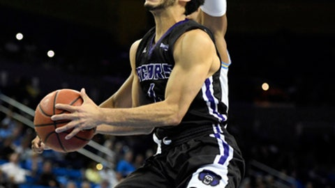 FILE - In this Nov. 15, 2017, file photo, Central Arkansas guard Jordan Howard shoots against UCLA during an NCAA college basketball game in Los Angeles. Two of the best 3-point shooters in college basketball are bonded by brotherhood. Marquette sophomore Markus Howard is averaging 22.3 points a game, and tied the Big East record after scoring 52 against Providence earlier this month. Older brother Jordan Howard plays at Central Arkansas and is the Southland Conference's career leader in 3s. (AP Photo/Michael Owen Baker, File)