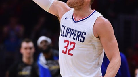 LOS ANGELES CA- JANUARY 15 Blake Griffin #32 of the LA Clippers celebrates a Houston Rockets foul during a 113-102 Clipper win at Staples Center